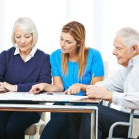 elderly couple looking at options
